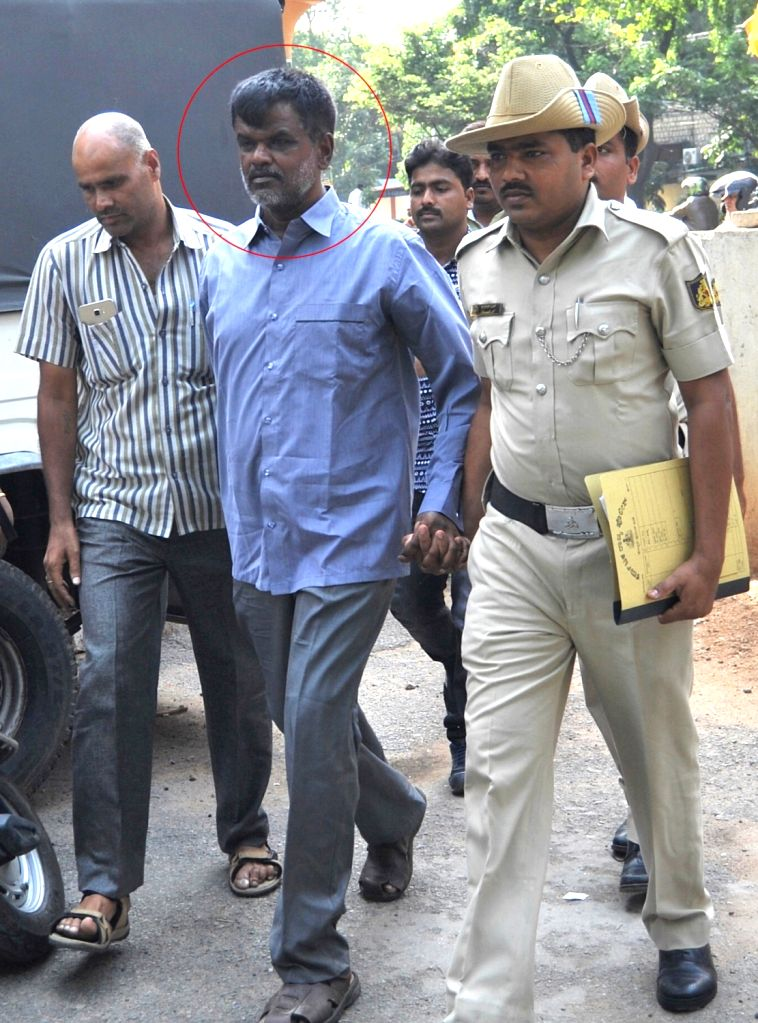 V Nagaraj being taken to be produced at City Civil Court at Mayo Hall , in connection with a money laundering case in Bengaluru on May 22, 2017.