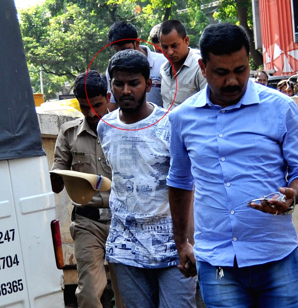 V Nagaraj's son Gandhi being taken to be produced at City Civil Court at Mayo Hall , in connection with a money laundering case in Bengaluru on May 22, 2017.