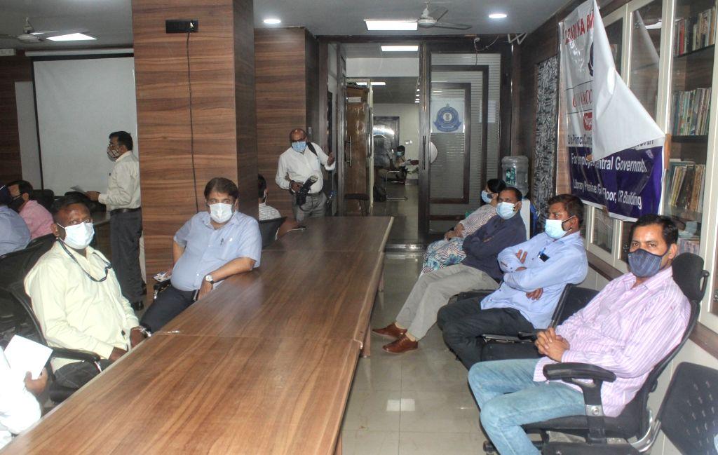 Vacination officer inject Covid-19 vacine for Income Tax Office Employees at Income Tax Office in new Delhi on Thuesday April 13, 2021.(Photo: Wasim Sarvar/IANS)