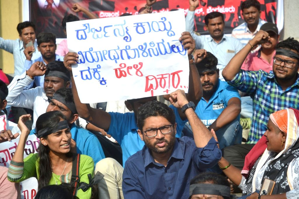 Vadgam MLA and dalit leader Jignesh Mevani stage a demonstration against the dilution of the SC/ST Prevention of Atrocities Act, in Bengaluru on April 4, 2018.