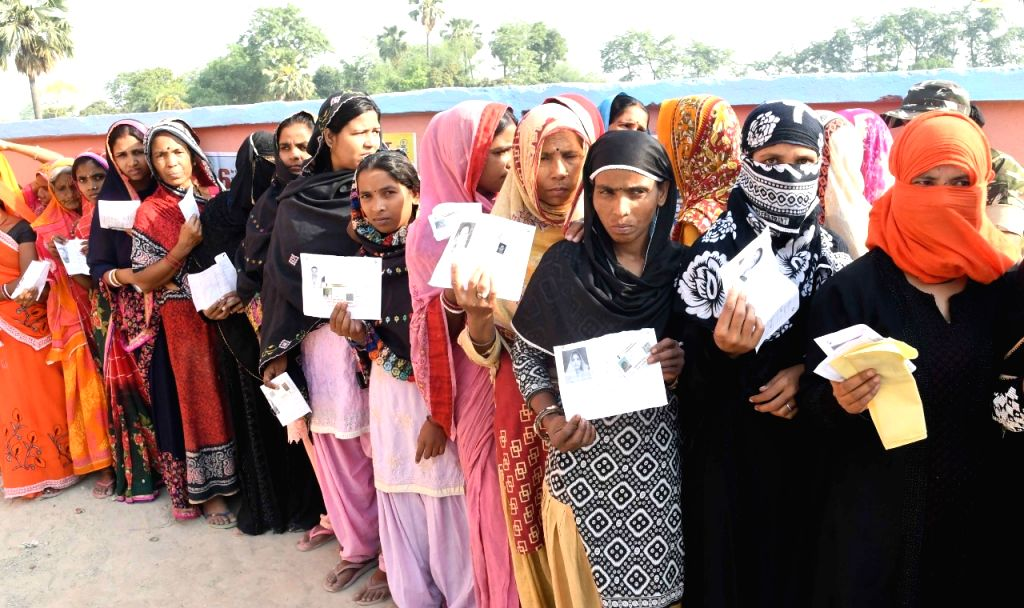 Vaishali: People queue up to cast their votes during the sixth phase of 2019 Lok Sabha elections, in Vaishali, Bihar on May 12, 2019. (Photo: IANS)