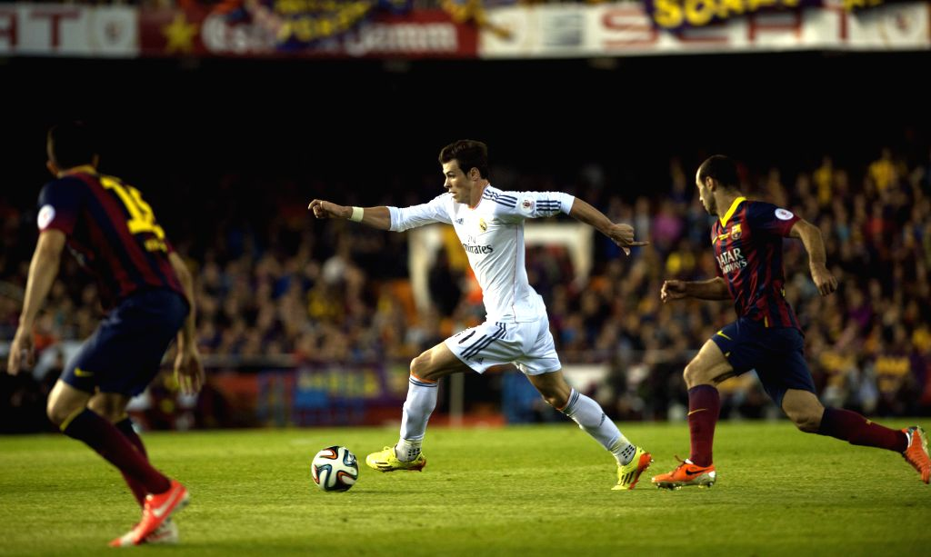 Gareth Bale (C) of Real Madrid breaks through during the Spanish King's Cup final between FC Barcelona and Real Madrid at the Mestalla stadium in Valencia, Spain .