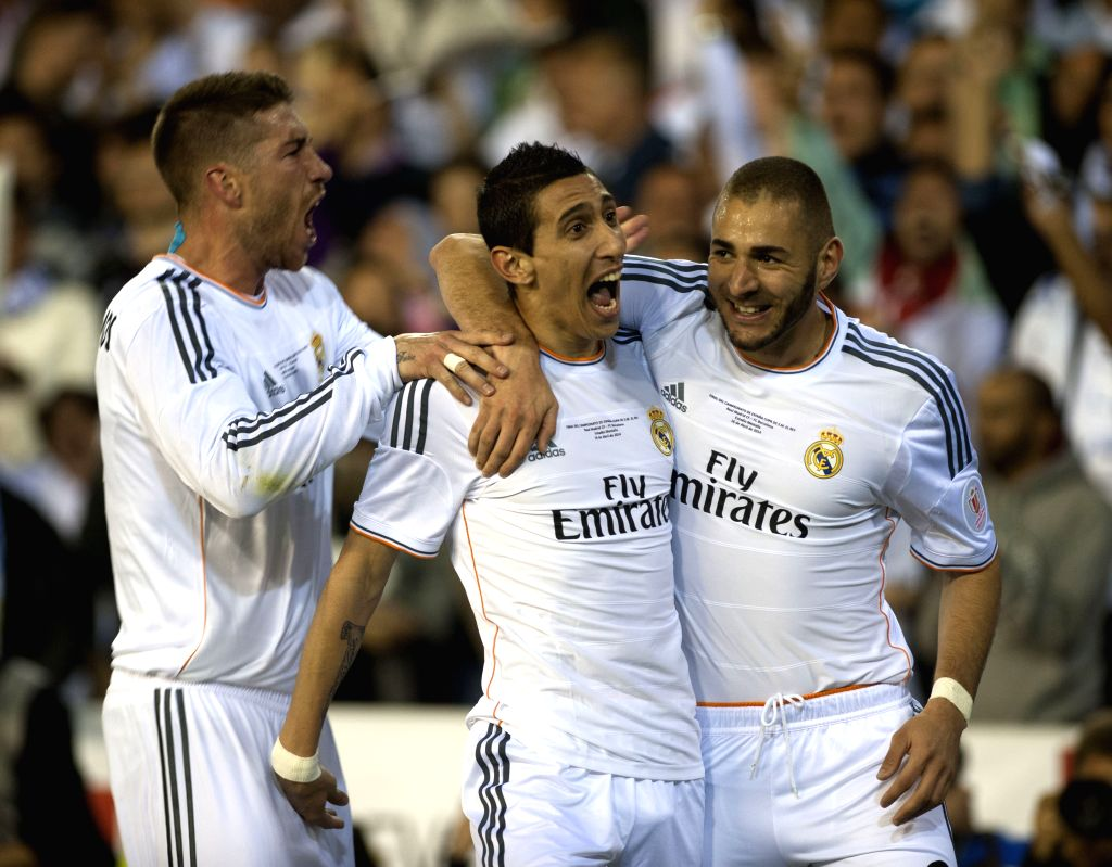 Players of Real Madrid celebrate after scoring during the Spanish King's Cup final between FC Barcelona and Real Madrid at the Mestalla stadium in Valencia, Spain