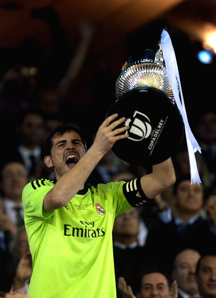 Real Madrid's goalkeeper Iker Casillas holds the trophy as he celebrates after winning the Spanish King's Cup final between FC Barcelona and Real Madrid at the ...