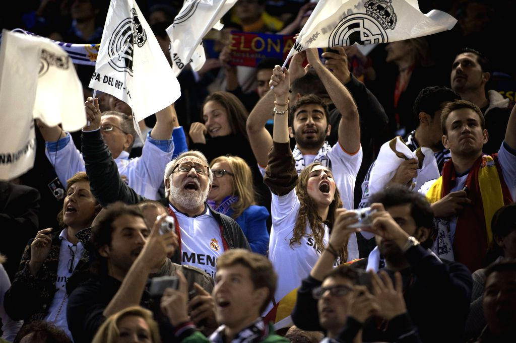 Supporters of Real Madrid celebrate their victory after the Spanish King's Cup final between FC Barcelona and Real Madrid at the Mestalla stadium in Valencia, ...