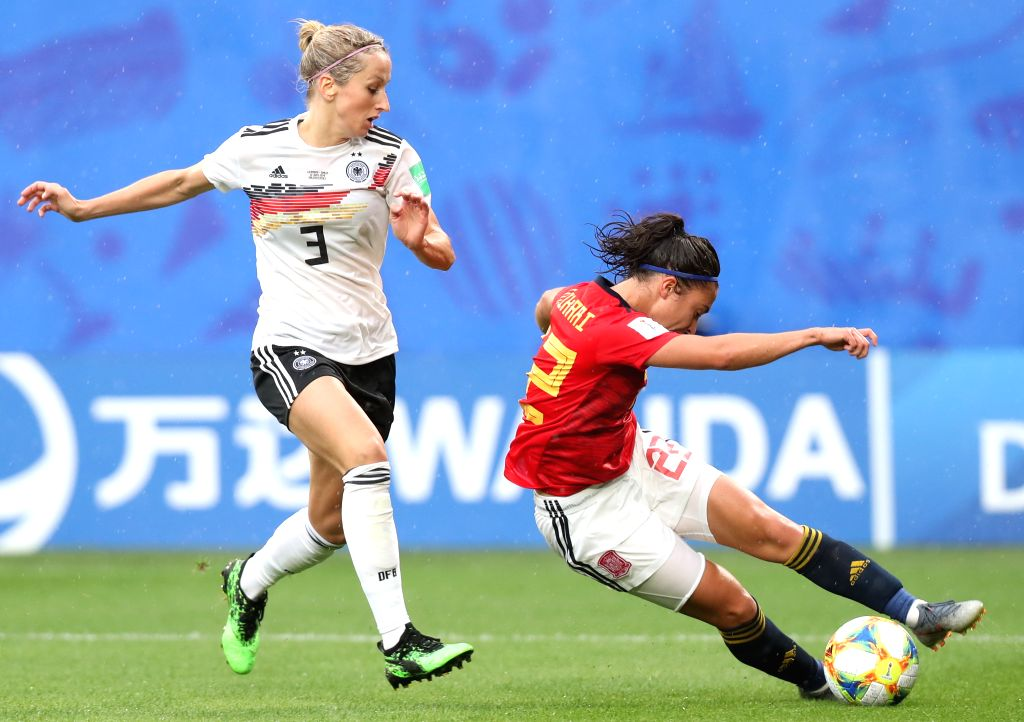 VALENCIENNES, June 13, 2019 - Kathrin Hendrich (L) of Germany vies with Nahikari Garcia of Spain during the Group B match between Germany and Spain at the 2019 FIFA Women's World Cup in Valenciennes, ...