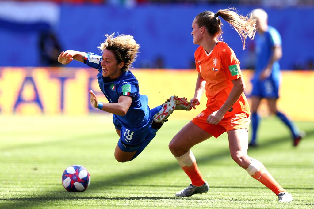 VALENCIENNES, June 29, 2019 (Xinhua) -- Valentina Giacinti (L) of Italy is fouled by Desiree Van Lunteren (R) of the Netherlands during the quarterfinal between Italy and the Netherlands at the 2019 FIFA Women's World Cup in Valenciennes, France, Jun