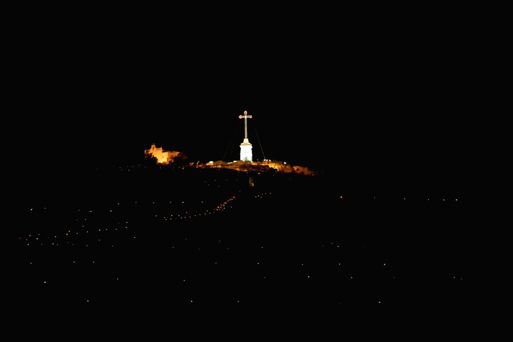 VALLETA, March 29, 2018 - The Laferla Cross is lit up and surrounded by petrol lanterns during a pilgrimage as part of Holy Week activities in Siggiewi, Malta, on March 29, 2018. Hundreds of people ...