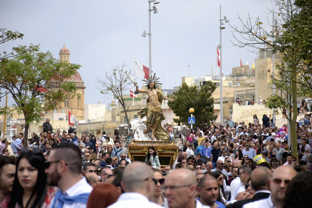 VALLETTA, April 16, 2017 - People attend the procession of Easter in the streets of Cospicua, Malta, April 16, 2017.