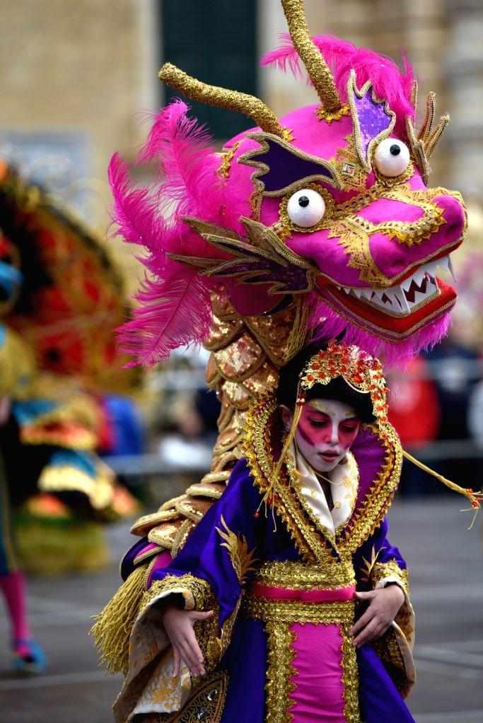 VALLETTA, Feb. 11, 2018 - A woman in a dragon costume attends a carnival parade in Valletta, Malta, on Feb. 11, 2018. Malta carnival 2018 celebrations started on Feb. 3 and will last till Feb. 13.