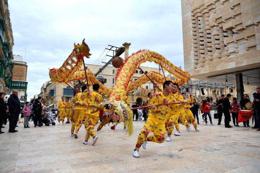 VALLETTA, Feb. 13, 2018 - Artists of China's Zhejiang Wu Opera Troupe perform dragon dance in Valletta, Malta, on Feb. 13, 2018. Artists of China's Zhejiang Wu Opera Troupe took part in Malta's ...