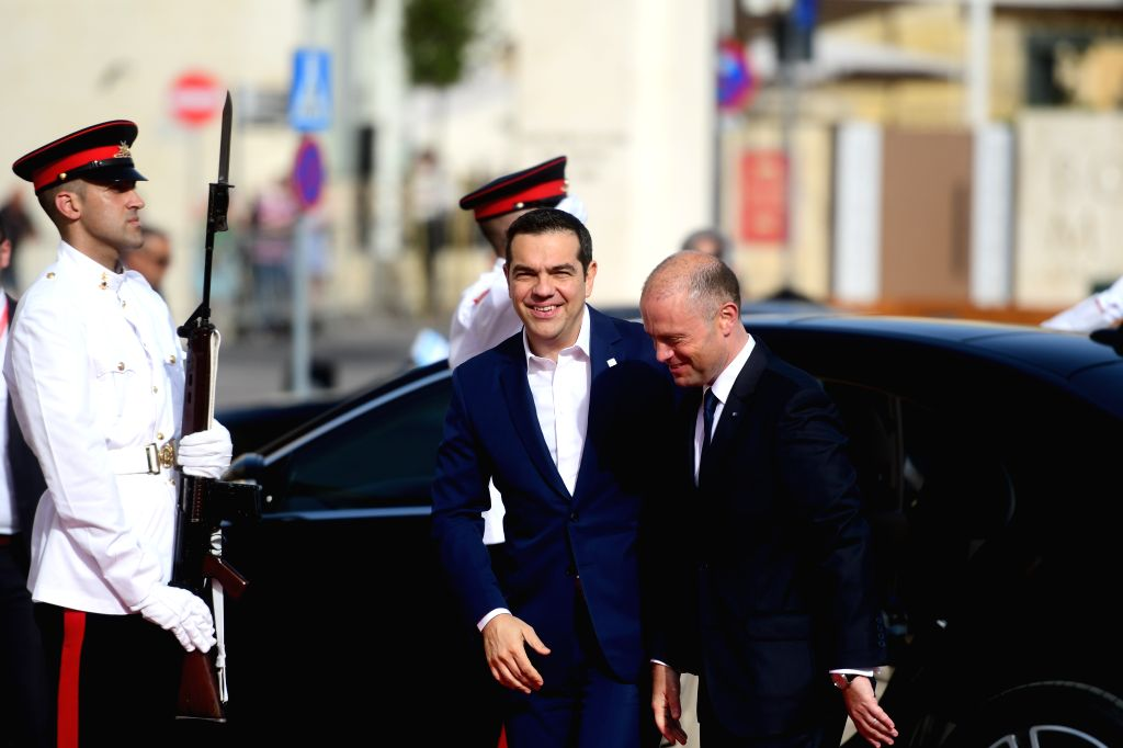 VALLETTA, June 15, 2019 - Maltese Prime Minister Joseph Muscat (R) greets Greek Prime Minister Alexis Tsipras in front of the Auberge De Castille at Valletta, capital of Malta, on June 14, 2019. ... - Joseph Muscat