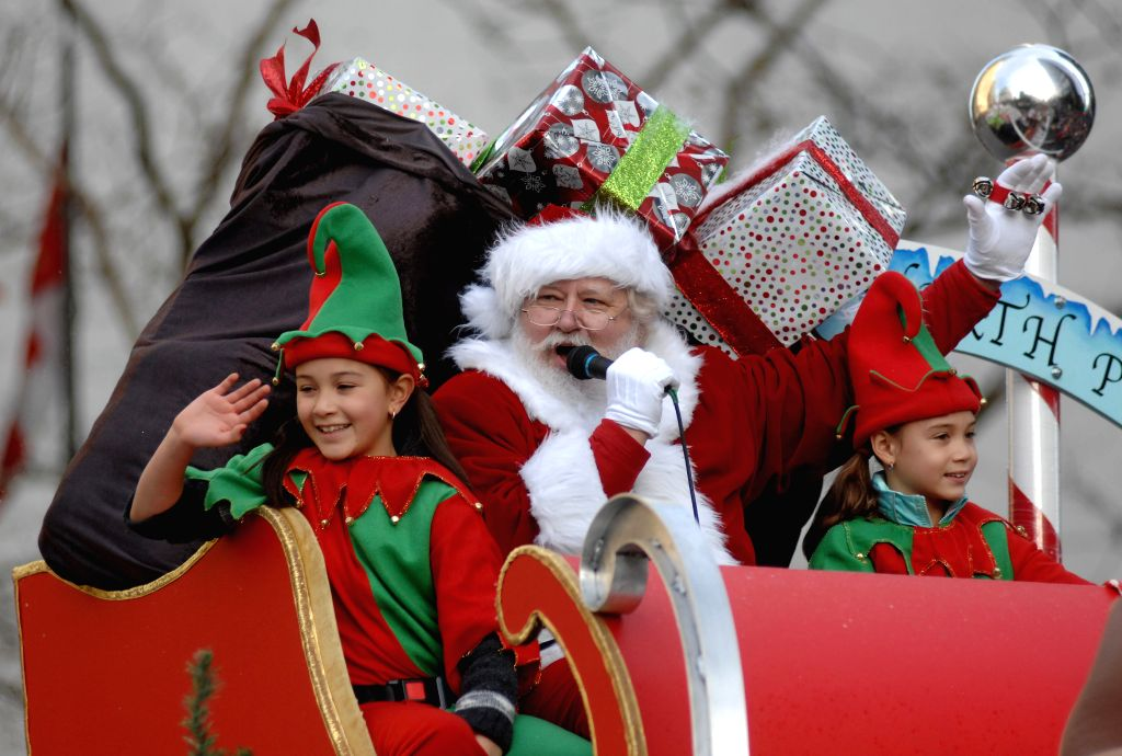 A man dressed as Santa waves his hands during the Santa Claus Parade in Vancouver, Canada, Dec. 7, 2014. The 11th annual parade attracted more than 300,000 spectators and featured 3,800 ...