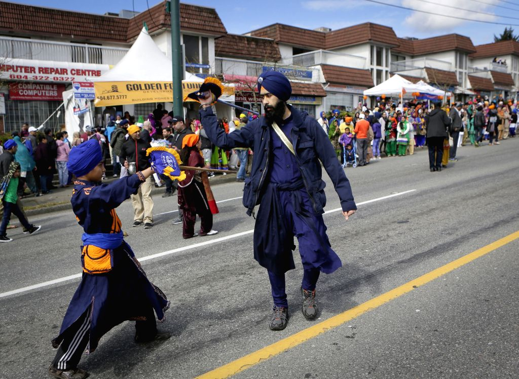 Participants perform along the street during the Vaisakhi parade in Vancouver, Canada, April 11, 2015. The Vaisakhi Day marks the start of the New Year of the ...