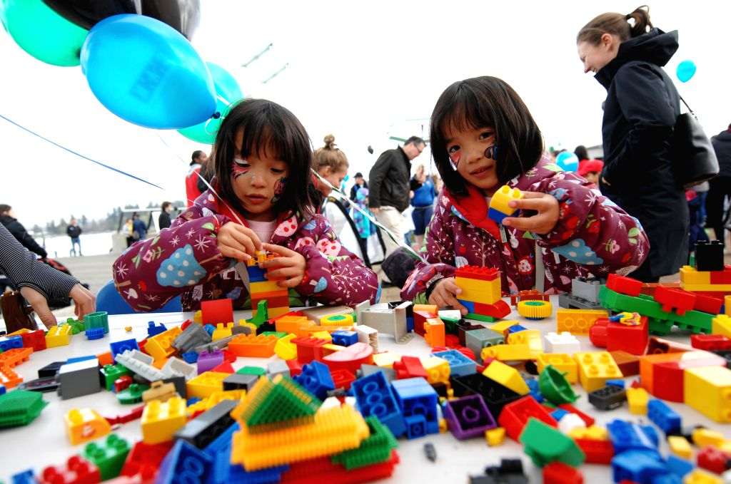 Girls play toys during a festival to enhance people's awareness for Autism, sponsored and organized by Canucks Autism Network, in Vancouver, Canada, April 12, ...