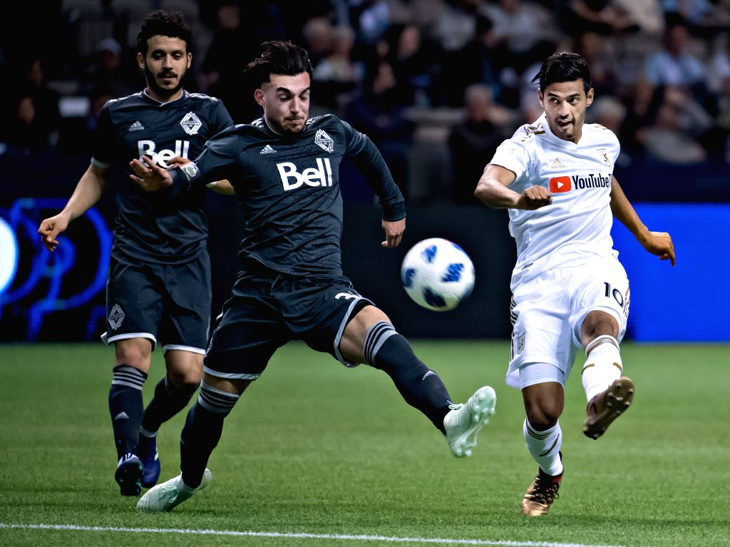 VANCOUVER, April 14, 2018 - Vancouver Whitecaps' Russell Tiebert (C) and vies with Los Angeles FC's Carlos Vela (R) during the Major League Soccer (MLS) regular season soccer match between Vancouver ...