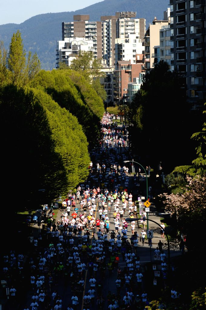 People take part in the 31st annual Vancouver Sun Run in Vancouver, Canada, April 19, 2015. The Vancouver Sun Run is Canada's largest 10km road race and is the ...