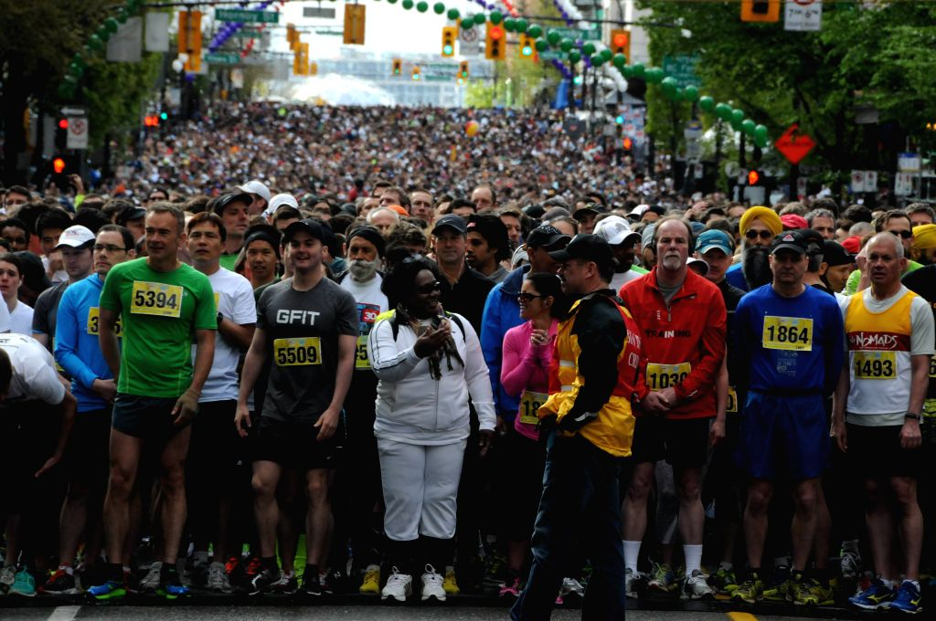 Runners start during the 30th Vancouver Sun Run in Vancouver, Canada, April 27, 2014. More than 50,000 people participated in this annual race. (Xinhua/Jiang ...