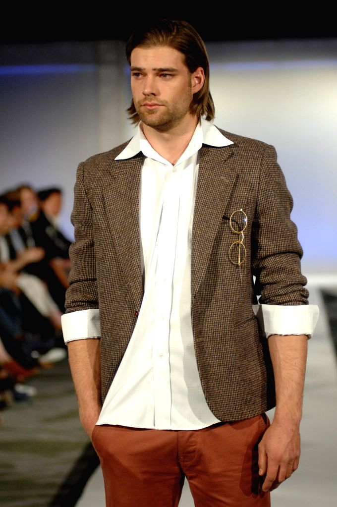 A model presents a creation by Canadian brand Man Up on the opening day of the 8th Eco-Fashion Week in Vancouver, Canada, on April 28, 2014. The Eco-Fashion Week