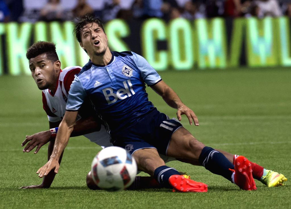 VANCOUVER, Aug. 13, 2016 - San Jose Earthquakes' Anibal Godoy (L) collides with Vancouver Whitecaps' Nicholas Mezquida during a Major League Soccer (MLS) match in Vancouver, Canada, Aug. 12, 2016.