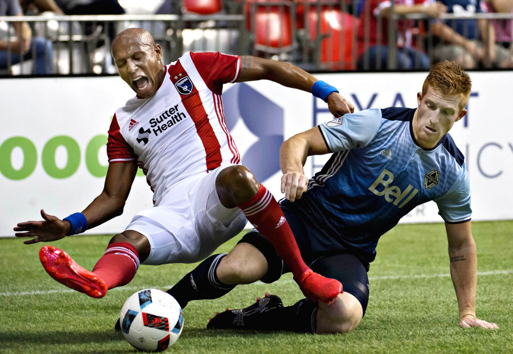 VANCOUVER, Aug. 13, 2016 - San Jose Earthquakes Jordan Stewart (L) vies for the ball with Vancouver Whitecaps' Tim Parker during a Major League Soccer (MLS) match in Vancouver, Canada, Aug. 12, 2016.