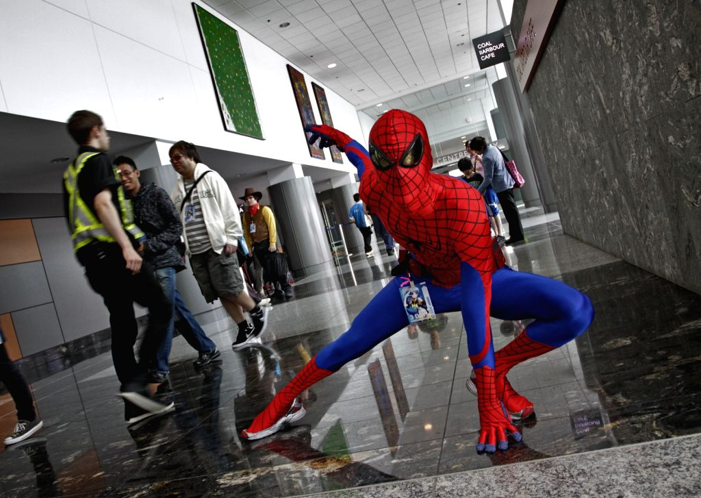 A man dressed as spiderman poses at the 11th Anime Revolution convention in Vancouver, Canada, Aug. 16, 2013. More than 3,000 spectators are expected to attend ...