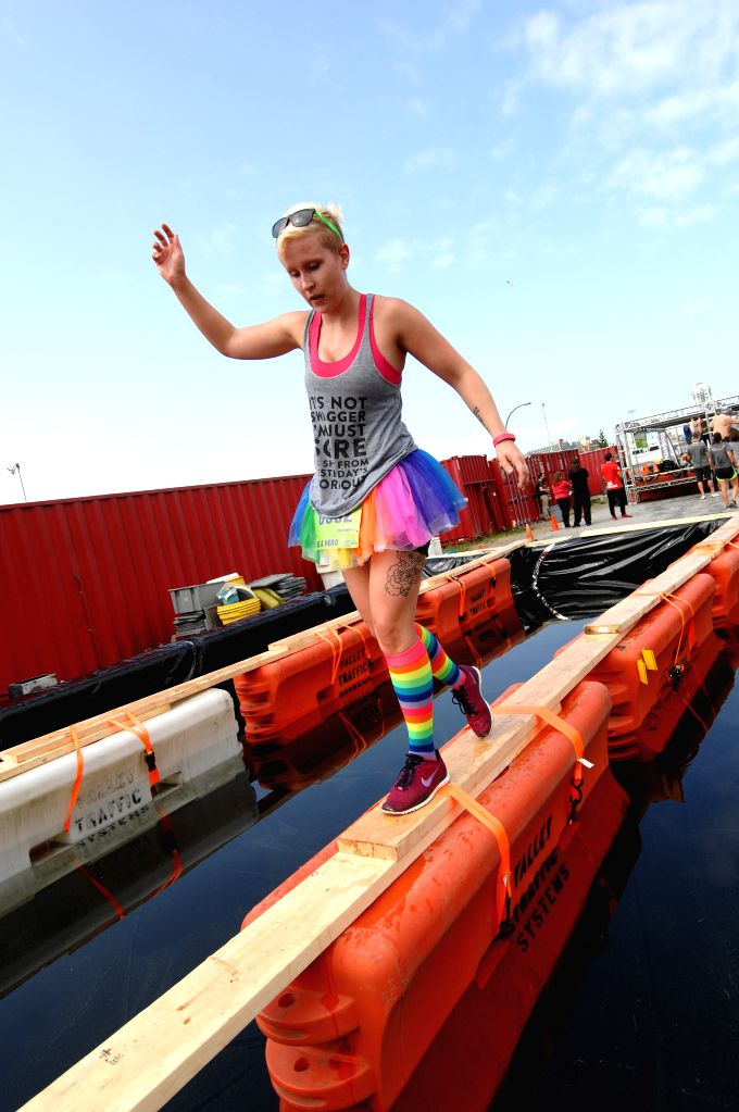 A runner takes part in the annual 2014 Concrete Hero obstacle race to raise funds in support of life-saving cancer research in Vancouver, Canada, Aug.17, 2014. ...