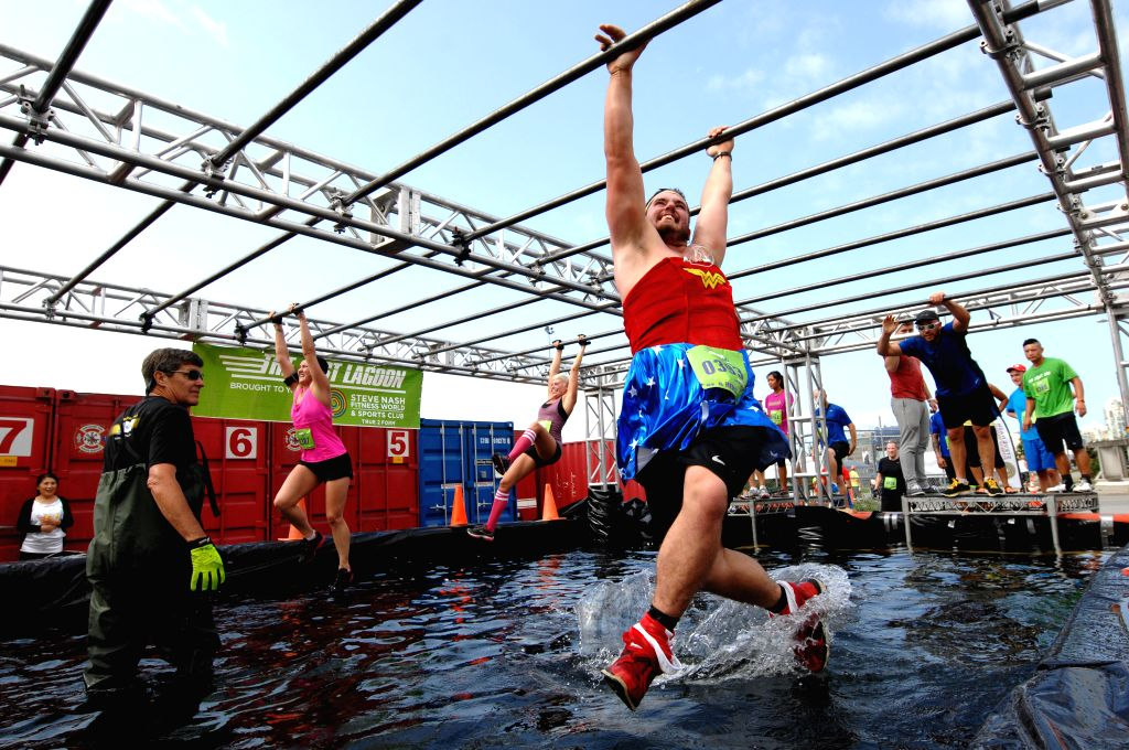 Participants take part in the annual 2014 Concrete Hero obstacle race to raise funds in support of life-saving cancer research in Vancouver, Canada, Aug.17, 2014.