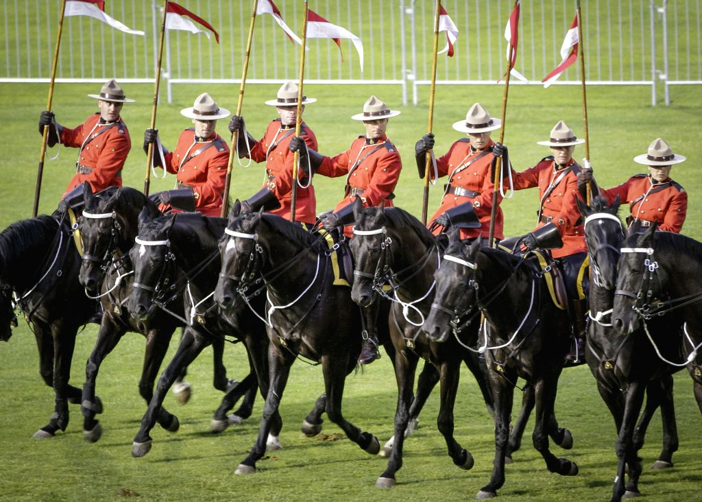 VANCOUVER, Aug. 19, 2017 - Riders and horses perform at the RCMP Musical Ride event at Burnaby's Central Park in Vancouver, Canada, Aug. 18, 2017. The Royal Canadian Mounted Police (RCMP) Musical ...