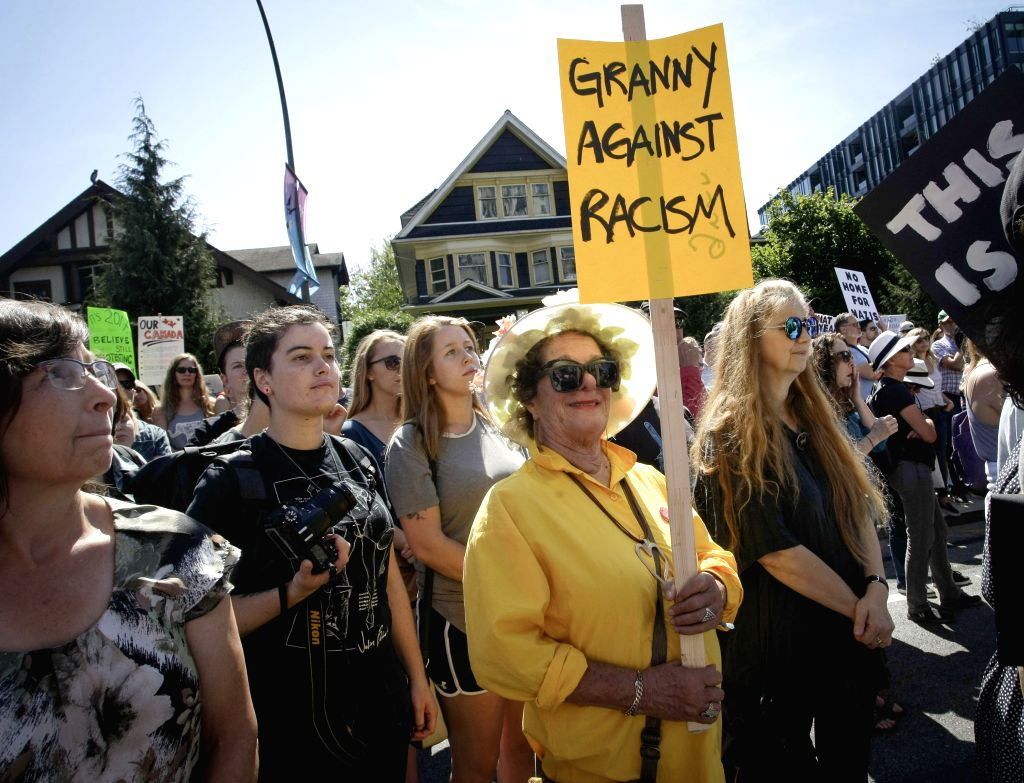 VANCOUVER, Aug. 20, 2017 - A protestor carries a sign during an anti-racism rally outside Vancouver City Hall in Vancouver, Canada, Aug. 19, 2017.