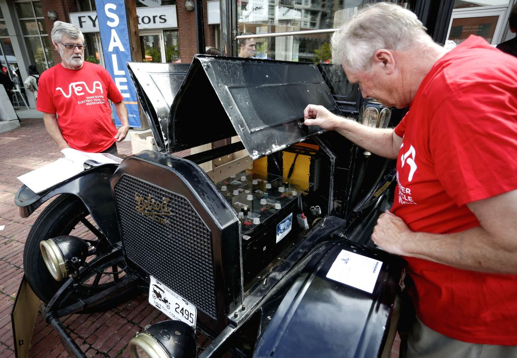 VANCOUVER, Aug. 25, 2019 - A man looks at the battery compartment of a vintage electric vehicle that built in 1912 during the 24th Electrafest in Vancouver, Canada, Aug. 24, 2019. Returned for its ...