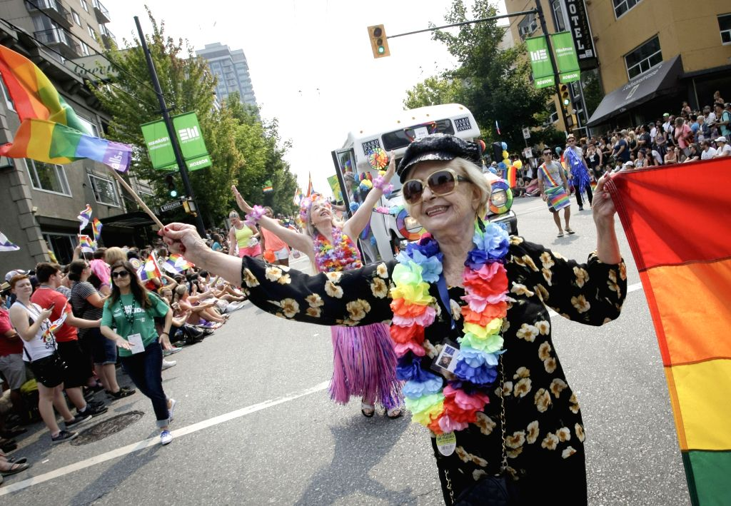 VANCOUVER, Aug. 7, 2017 - A participant waves a rainbow flag during the 39th Vancouver Pride Parade in Vancouver, Canada, Aug. 6, 2017. The Pride Parade in Vancouver is a celebration of culture and ...