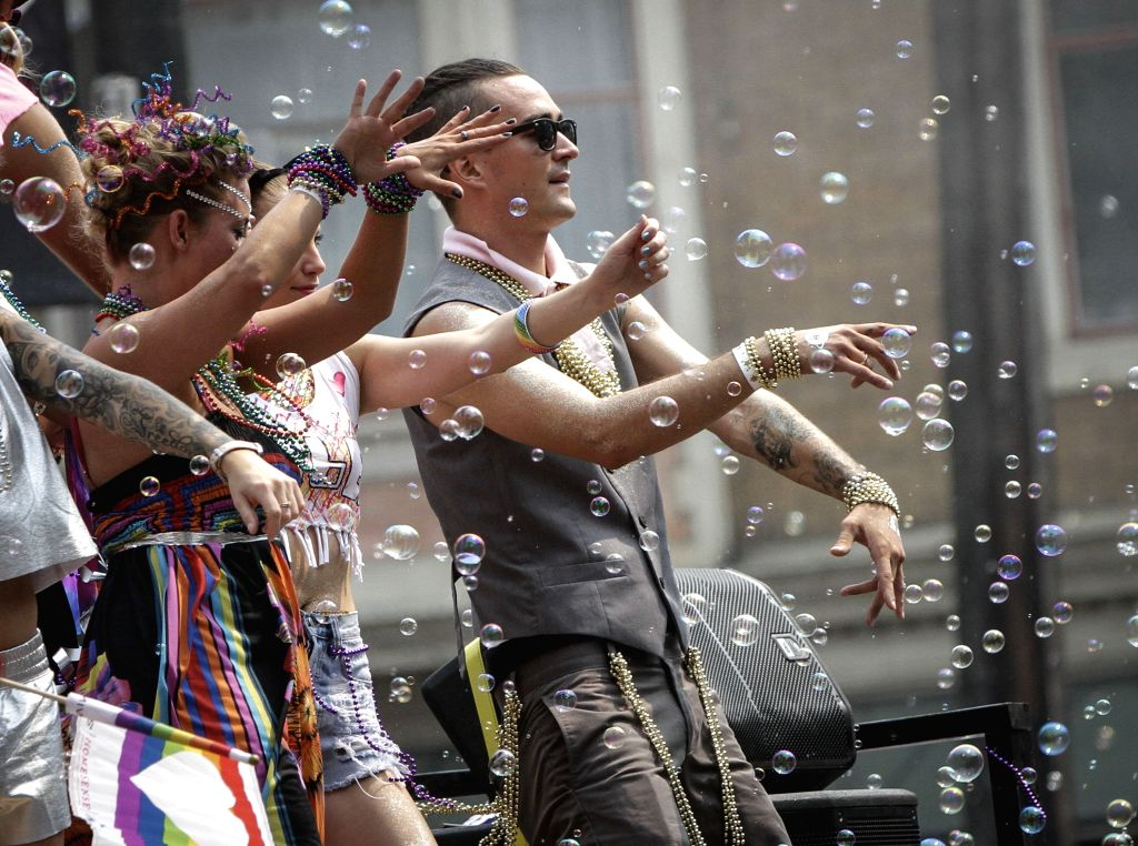 VANCOUVER, Aug. 7, 2017 - Participants dance during the 39th Vancouver Pride Parade in Vancouver, Canada, Aug. 6, 2017. The Pride Parade in Vancouver is a celebration of culture and diversity.