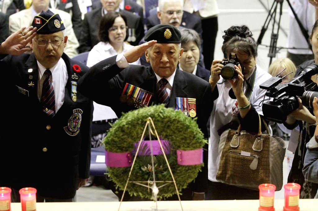 VANCOUVER(CANADA), Canada, Aug. 16, 2015  - Veterans of World War II participate in a commemoration ceremony at Chinatown in Vancouver, Canada, Aug. 15, 2015. Chinese-Canadians, dignitaries ...