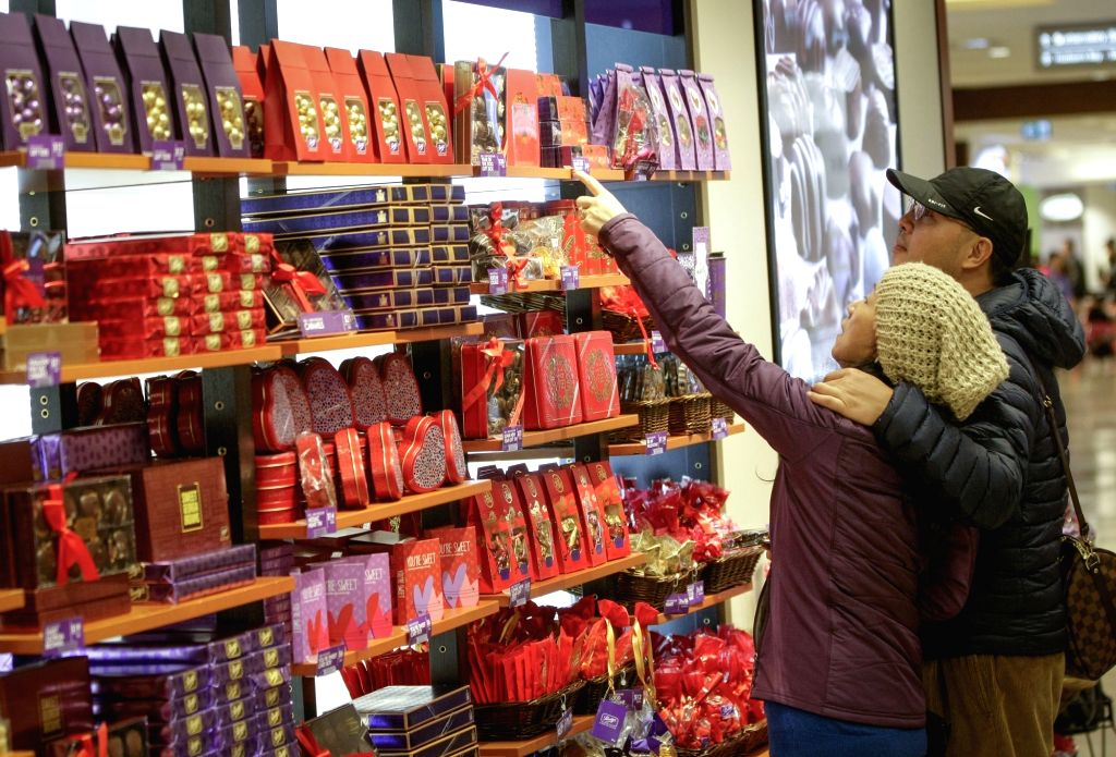 VANCOUVER (CANADA), Feb. 13, 2018 Customers choose chocolates at a candy shop in Vancouver, Canada, on Feb. 13, 2018. Chocolate retailers in Vancouver prepared a variety of ...