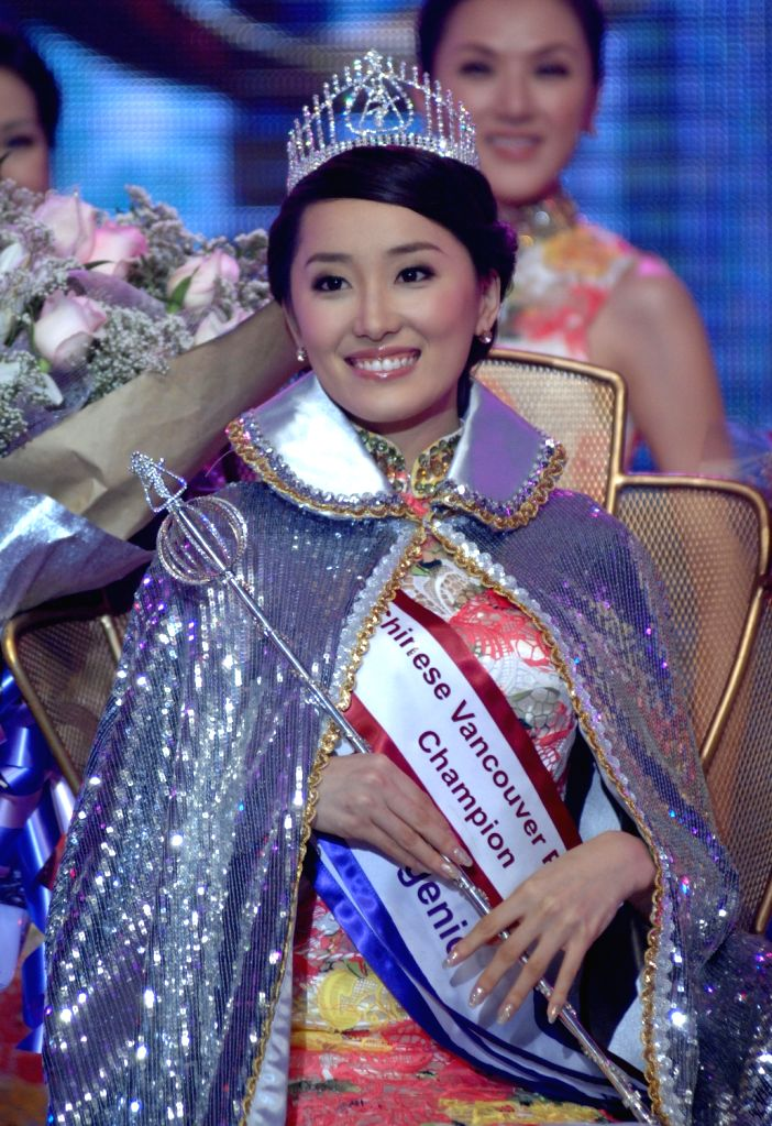 Cindy Zhong poses after being crowned the Miss Chinese Vancouver 2013 in Vancouver, Canada, on Dec. 12, 2013. She will represent Vancouver at Miss Chinese ...