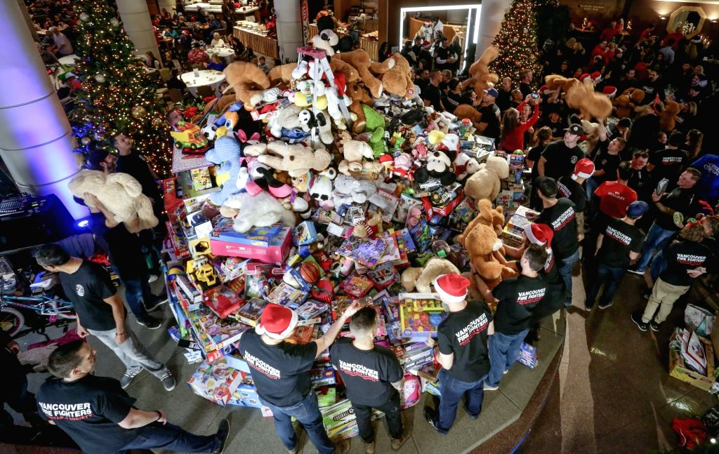 VANCOUVER, Dec. 13, 2018 - Toys are piled up during the 31st annual Pan Pacific Vancouver Christmas Wish Breakfast in Vancouver, Canada, on Dec. 13, 2018. As one of Canada's largest toy drive events, ...