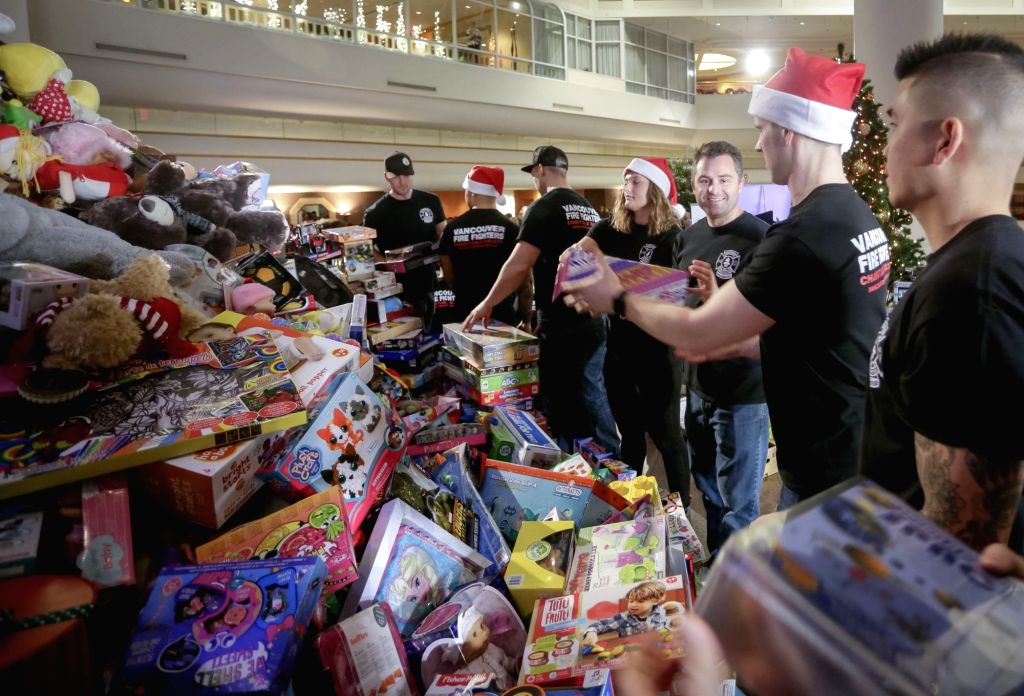 VANCOUVER, Dec. 13, 2018 - Volunteers pile up toys during the 31st annual Pan Pacific Vancouver Christmas Wish Breakfast in Vancouver, Canada, on Dec. 13, 2018. As one of Canada's largest toy drive ...