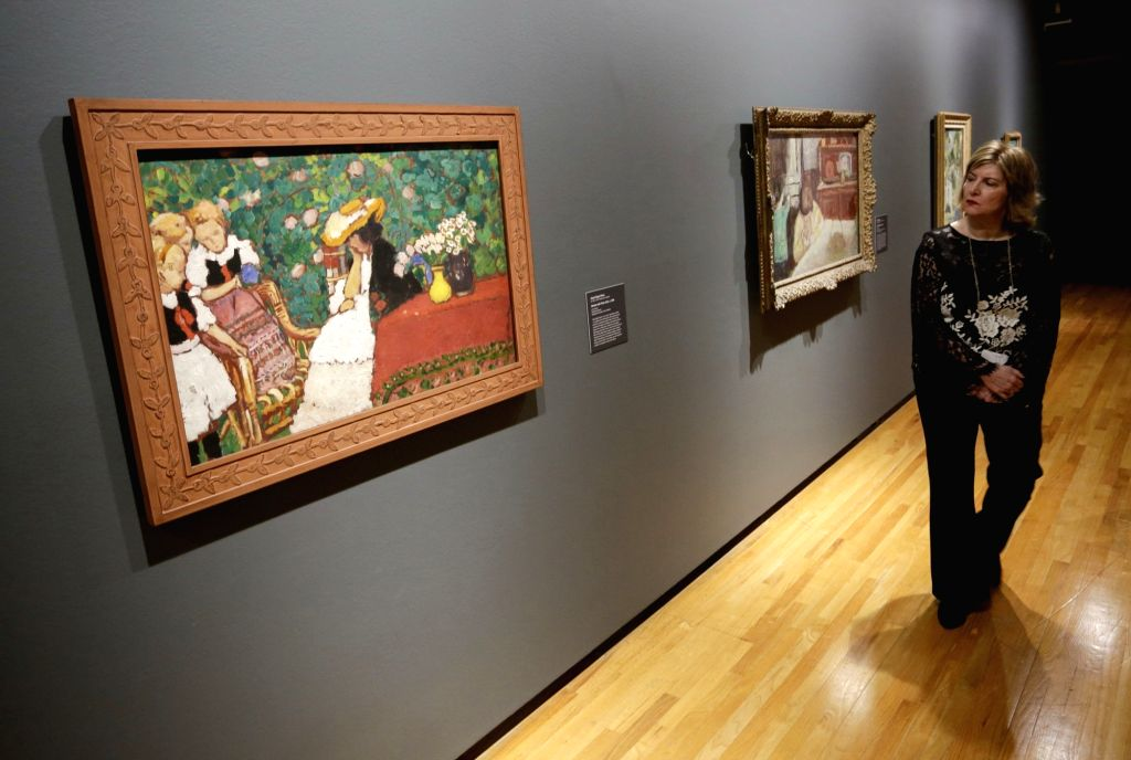 """VANCOUVER, Feb. 28, 2019 - A visitor views paintings at an exhibition entitled """"French Moderns: Monet to Matisse, 1850-1950"""" at the Vancouver Art Gallery in Vancouver, Canada, Feb. 28, ..."""
