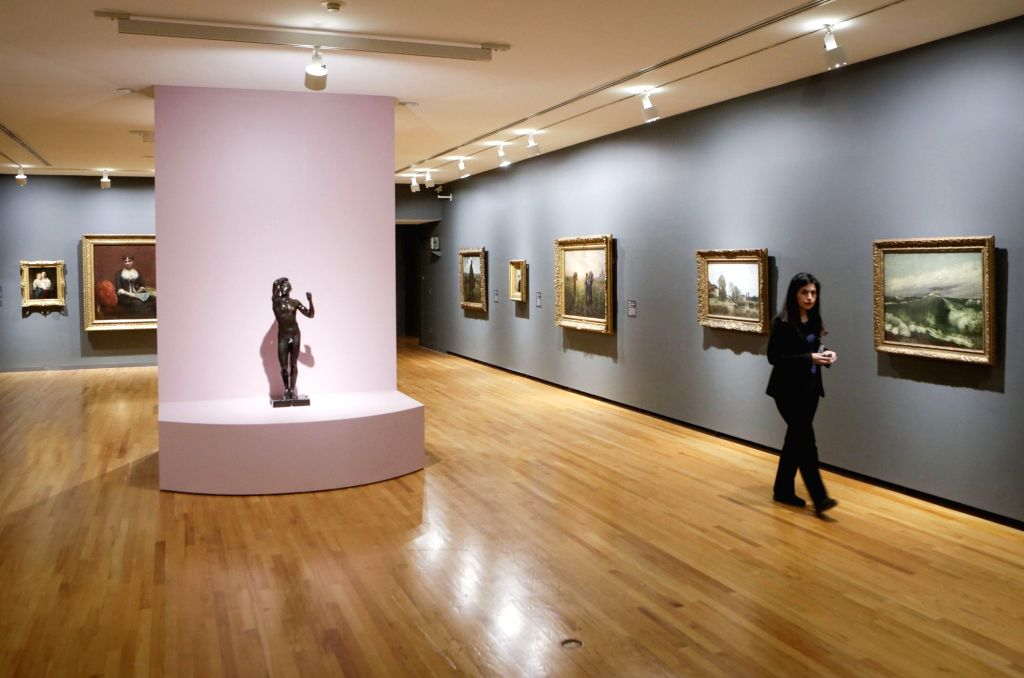 """VANCOUVER, Feb. 28, 2019 - A woman walks by paintings at an exhibition entitled """"French Moderns: Monet to Matisse, 1850-1950"""" at the Vancouver Art Gallery in Vancouver, Canada, Feb. 28, ..."""