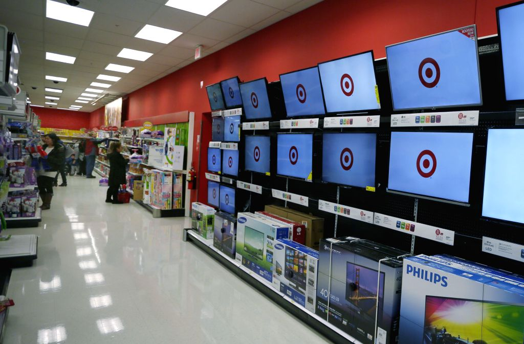 TV screens display the Target's logo at a Target store in Richmond, Canada, Jan. 15, 2015. Target will discontinue operating stores in Canada, a market that it ...
