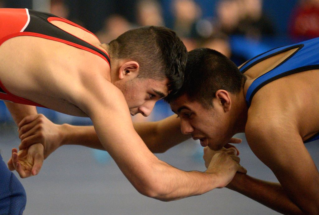 Canada's Arshpreet Gill (R) competes with his compatriot Sanan Pourshakoori during the opening day of the 2015 Western Canada Age Class Wrestling Championship in .