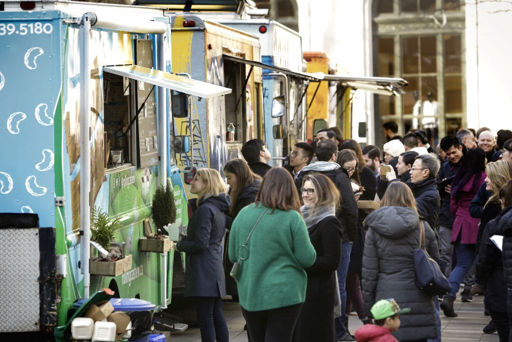 """VANCOUVER, Jan. 27, 2018 - People line up in front of food carts during the 7th annual """"Street Food City"""" event outside Vancouver Art Gallery in Vancouver, Canada, Jan. 26, 2018. The ..."""