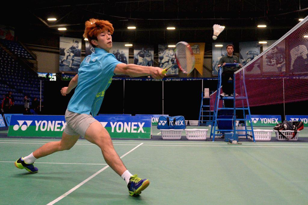 Yoon Cheol Kim of South Korea hits a return to James Pin Kuan Ho of Canada at the Yonex Canada Open GrandPrix 2014 badminton tournament in Vancouver, Canada, June .