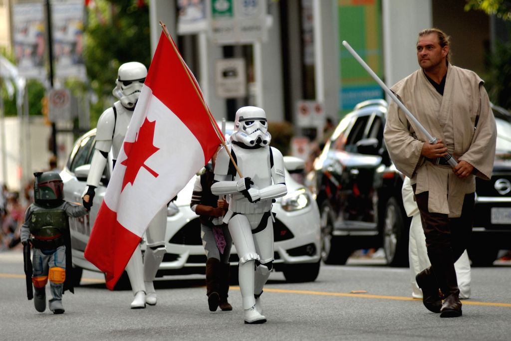 Participants take part in the annual Canada Day Parade in Vancouver, Canada, on July 1, 2014. Celebrations were held across the country to mark the 147th ...