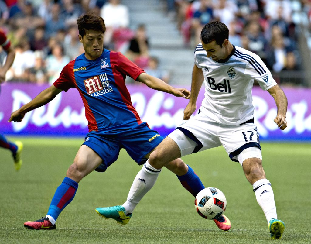 VANCOUVER, July 20, 2016 - Lee Chungyong (L) of Crystal Palace vies with Andrew Jacobson of Vancouver Whitecaps during their international friendly soccer match at BC Place in Vancouver, Canada, on ...