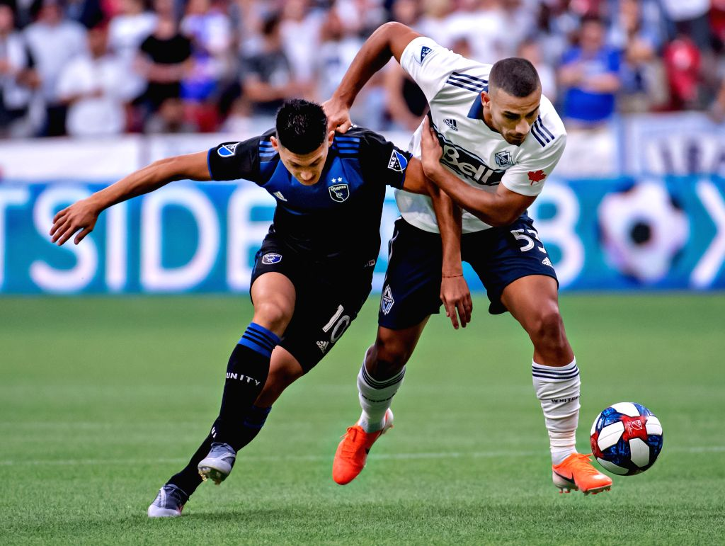 VANCOUVER, July 21, 2019 - San Jose Earthquakes' Cristian Espinoza (L) and Vancouver Whitecaps FC's Ali Adnan compete for the ball during the MLS soccer game in Vancouver, Canada, July, 20, 2019. The ...