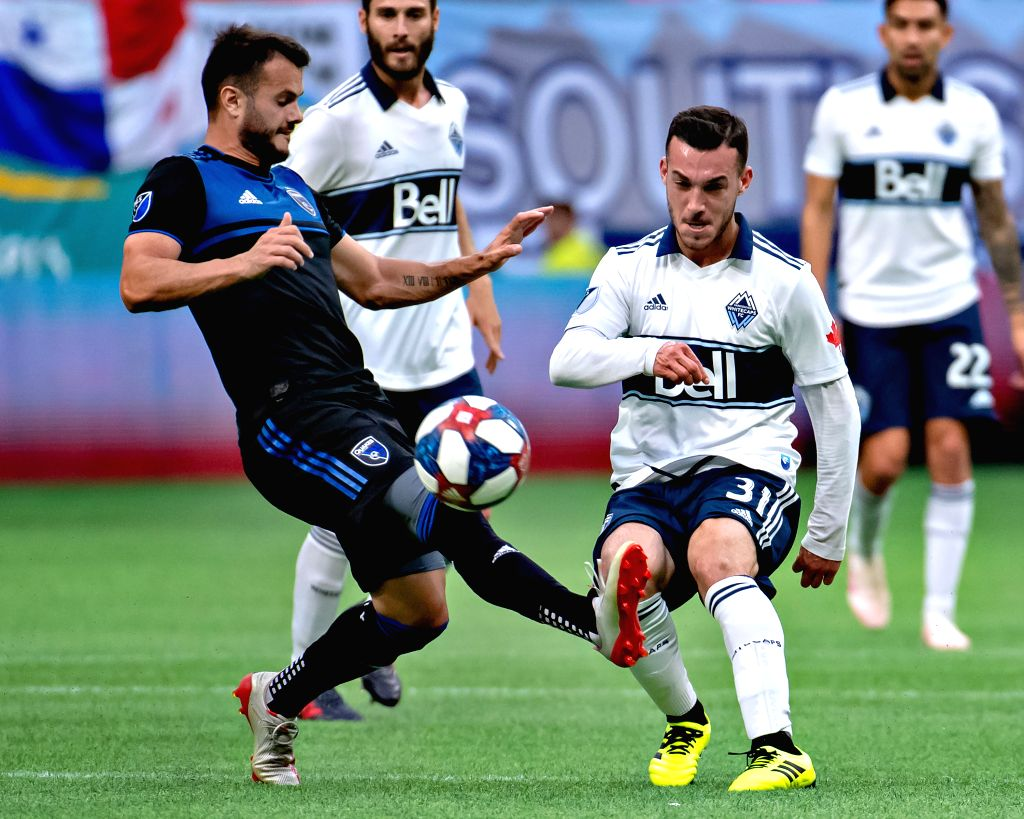 VANCOUVER, July 21, 2019 - San Jose Earthquakes' Valeri Qazaishvili (L) and Vancouver Whitecaps FC's Russell Teibert compete for the ball during the MLS soccer game in Vancouver, Canada, July, 20, ...