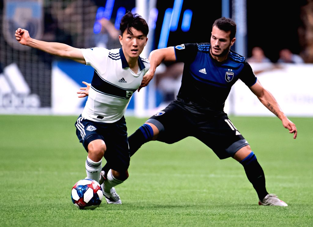 VANCOUVER, July 21, 2019 - Vancouver Whitecaps FC's Hwang In-Beom (L) and San Jose Earthquakes' Valeri Qazaishvili compete for the ball during the MLS soccer game in Vancouver, Canada, July, 20, ...