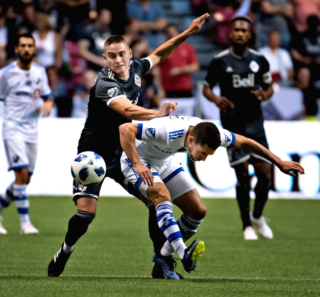 VANCOUVER, July 26, 2018 - Jake Nerwinski (front L) of Vancouver Whitecaps FC and Daniel Lovitz of Montreal Impact battle for the ball during the semifinal matches of the Canadian Championship at BC ...